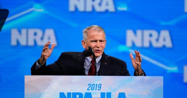 National Rifle Association President Col. Oliver North speaks at the National Rifle Association Institute for Legislative Action Leadership Forum in Lucas Oil Stadium in Indianapolis. On Saturday, North announced that he will not serve a second term as t