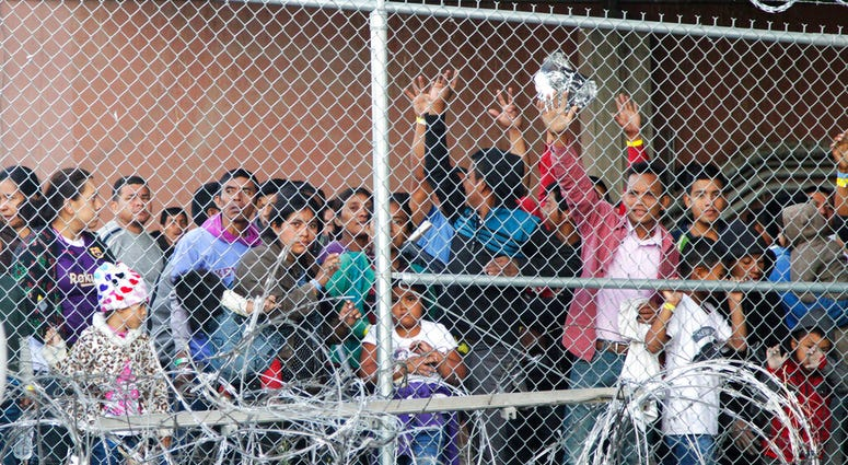 Central American migrants wait for food in El Paso, Texas, Wednesday, March 27, 2019, in a pen erected by U.S. Customs and Border Protection to process a surge of migrant families and unaccompanied minors.