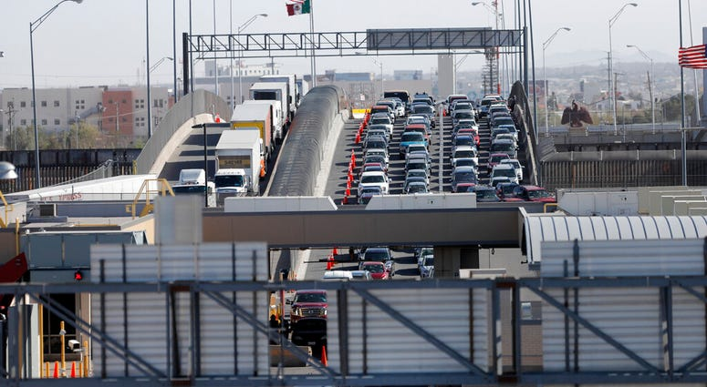 Cars and trucks line up to enter the U.S. from Mexico at a border crossing in El Paso, Texas,