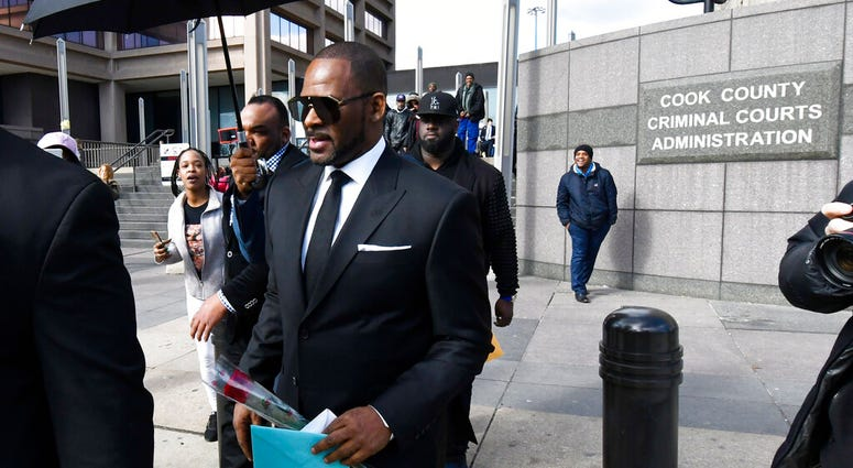 R. Kelly, front, leaves the Leighton Criminal Court after a hearing on Friday, March 22, 2019, in Chicago.