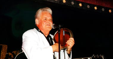 """This 2002 photo released by Redbush Classics Records shows rockabilly Hall of Famer Billy Adams performing in Hemsby, England. Adams, who wrote and recorded a rockabilly staple """"Rock, Pretty Mama,"""" died Saturday, March 30, 2019, in Westmoreland, Tenn. He"""