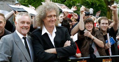 members of the rock band Queen, Roger Taylor, front left, and Brian May, front right,