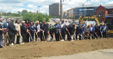 Officials and community leaders broke ground today on a $32 million park to be built on a bridge or cap over Pittsburgh's Crosstown Expressway