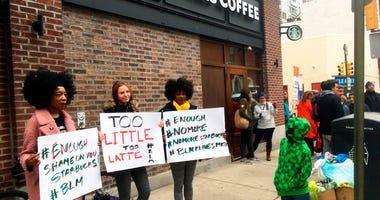 Protesters gather outside a Starbucks in Philadelphia