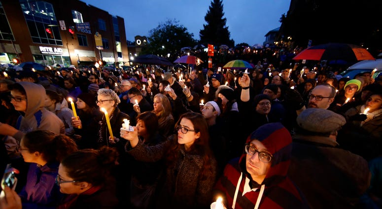 People hold candles as they gather for a vigil in the aftermath of a deadly shooting at the Tree of Life Congregation, in the Squirrel Hill