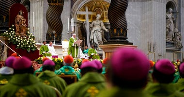 Pope Francis celebrates a Mass for the closing of the synod of bishops in St. Peter's Basilica at the Vatican Sunday