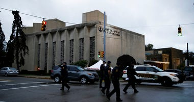 Police officers walk outside the Tree of Life Synagogue