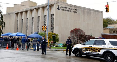 Pittsburgh Police direct traffic as their vehicles close the street adjacent to the Tree of Life Synagogue on Saturday, Nov. 3, 2018
