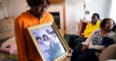 Glenda O'Neal, mother of of Dr. Tamara O'Neal, shows a photo of her family at their home in LaPorte, Ind., T