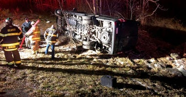 photo provided by WOAY-TV authorities respond after a charter bus carrying a high school girls basketball team rolled over in Oak Hill, W.Va.