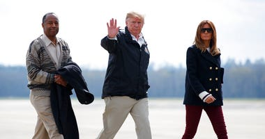 President Donald Trump, first lady Melania Trump and Secretary of Housing and Urban Development Ben Carson
