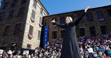 Sen. Elizabeth Warren, D-Mass., acknowledges cheers as she takes the stage during an event to formally launch her presidential campaign in Lawrence, Mass