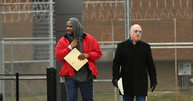 Singer R. Kelly left, walks with his attorney Steve Greenberg right, after being released from Cook County Jail, March 9, 2019