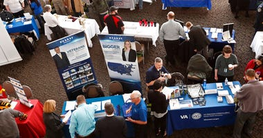 visitors to the Pittsburgh veterans job fair meet with recruiters at Heinz Field in Pittsburgh. On Friday, May 3, the U.S. government issues the April jobs report.