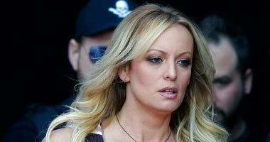 "adult film actress Stormy Daniels arrives at the adult entertainment fair ""Venus"" in Berlin. Daniels has agreed to dismiss a lawsuit that accused her former lawyer of colluding with President Donald Trump's ex-lawyer, Michael Cohen, to have her deny havin"