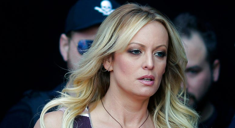 """adult film actress Stormy Daniels arrives at the adult entertainment fair """"Venus"""" in Berlin. Daniels has agreed to dismiss a lawsuit that accused her former lawyer of colluding with President Donald Trump's ex-lawyer, Michael Cohen, to have her deny havin"""