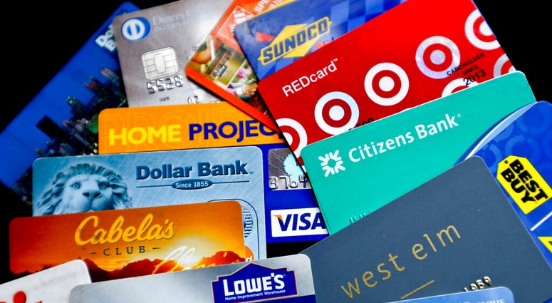 an assortment of credit cards and rewards cards are shown in Zelienople, Pa