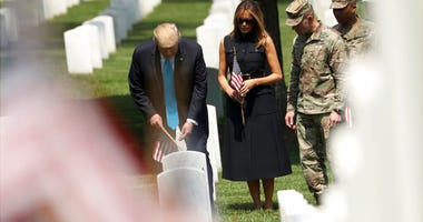 President Donald Trump and first lady Melania Trump visit Arlington National Cemetery for the annual Flags In ceremony ahead of Memorial Day Thursday, May 23, 2019, in Arlington, Va.