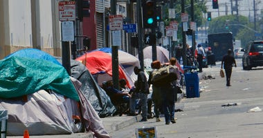 tents housing homeless line a street in downtown Los Angeles