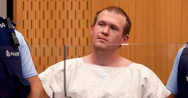 Brenton Tarrant, the man charged in the Christchurch mosque shootings, appears in the Christchurch District Court, in Christchurch, New Zealand. The man accused of killing 51 people at two Christchurch mosques on Friday, June 14, 2019, pleaded not guilty