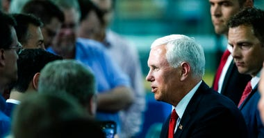 Vice President Mike Pence meets with people at JLS Automation in York, Pa., Thursday, June 6, 2019.