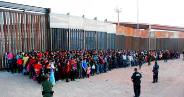 May 29, 2019 file photo released by U.S. Customs and Border Protection (CBP) shows some of 1,036 migrants who crossed the U.S.-Mexico border in El Paso, Texas