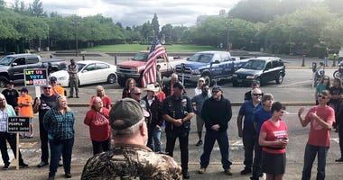 a small crowd of local Republicans show their support of a Republican walkout outside the Oregon State Capitol in Salem, Ore.