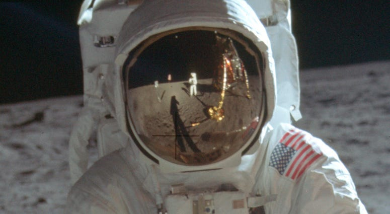 Neil Armstrong reflected in the helmet visor of Buzz Aldrin on the surface of the moon.