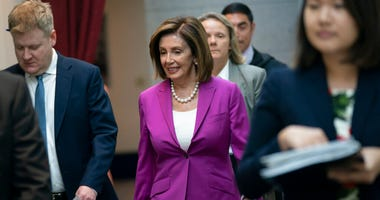 """House Speaker Nancy Pelosi, D-Calif., arrives for a closed-door session with her caucus before a vote on a resolution condemning what she called """"racist comments"""" by President Donald Trump at the Capitol in Washin"""