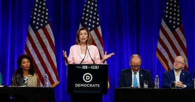 U.S. House Speaker Nancy Pelosi gestures while speaking at the Democratic National Committee's summer meeting Friday, Aug. 23,
