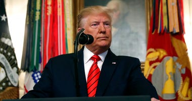 President Donald Trump speaks in the Diplomatic Room of the White House in Washington, Sunday, Oct. 27, 2019.