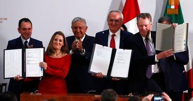 Mexico's Treasury Secretary Arturo Herrera, left, Deputy Prime Minister of Canada Chrystia Freeland, second left, Mexico's President Andres Manuel Lopez Obrador, center, Mexico's top trade negotiator Jesus Seade, second right, and U.S. Trade Representativ