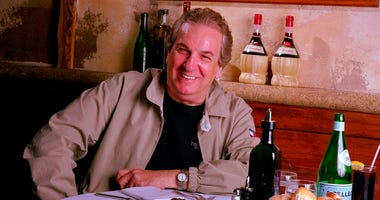 In this July 28, 2001 file photo, Danny Aiello poses for a photo at Gigino restaurant in New York.