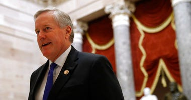 Rep. Mark Meadows, R-N.C., walks on Capitol Hill in Washington, Wednesday, Dec. 18, 2019