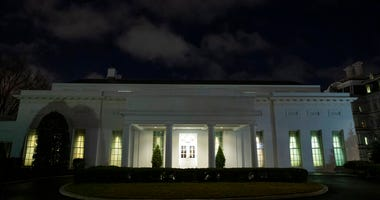 All the lights are on in the windows of the West Wing of the White House after news of a missile attack on an Iraqi air base housing U.S. troops, Tuesday, Jan. 7, 2020, in Washington.