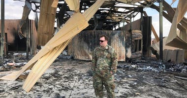 A U.S. soldier stands at a site of Iranian bombing, in Ain al-Asad air base, Anbar, Iraq, Monday, Jan. 13, 2020.