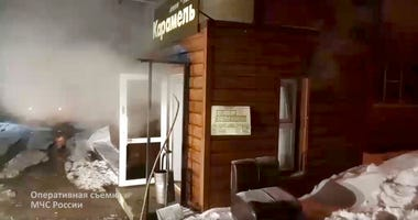 In this image made from video provided by Russian Emergency Situations Ministry press service, shows a view of a damaged hotel of nine rooms located in the basement of a residential building which was flooded with boiling water after a pipe ruptured in Pe