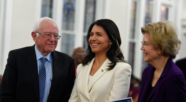 US. Sen. Bernie Sanders, left, I-Vt., U.S. Rep. Tulsi Gabbard, center, D-Hawaii, and Sen. Elizabeth Warren, right, D--Mass., speak at a Martin Luther King Jr. Day services at Zion Baptist Church, Monday, Jan. 20, 2020, in Columbia, S.C.