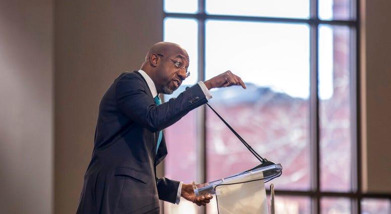 The Rev. Raphael G. Warnock speaks during the Martin Luther King, Jr. annual commemorative service at Ebenezer Baptist Church in Atlanta on Monday, Jan. 20, 2020.