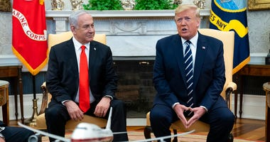 President Donald Trump speaks during a meeting with Israeli Prime Minister Benjamin Netanyahu in the Oval Office of the White House, Monday, Jan. 27, 2020, in Washington.