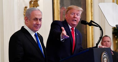 President Donald Trump speaks during an event with Israeli Prime Minister Benjamin Netanyahu in the East Room of the White House in Washington, Tuesday, Jan. 28, 2020. (