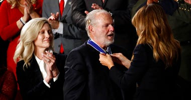 First Lady Melania Trump presents the Presidential Medal of Freedom to Rush Limbaugh as his wife Kathryn watches during the State of the Union address to a joint session of Congress on Capitol Hill in Washington, Tuesday, Feb. 4, 2020.
