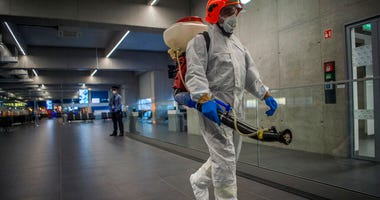 Disinfection equipment is carried by a worker as precautionary measures against the spreading of novel coronavirus, at Budapest Liszt Ferenc International Airport in Budapest, Hungary, Wednesday, Feb. 5, 2020. So far almost 900 passenger arriving directly