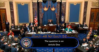 the vote total, 52-48 for not guilty, on the first article of impeachment, abuse of power, is displayed on screen during the impeachment trial against President Donald Trump in the Senate at the U.S. Capitol in Washington, Wednesday, Feb. 5, 2020.