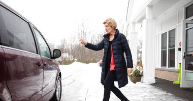Democratic presidential candidate Sen. Elizabeth Warren, D-Mass., departs after a visit to the Great Bay Kids' Company, Thursday, Feb. 6, 2020, in Exeter, N.H.