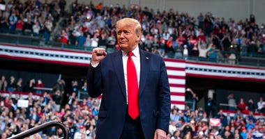 President Donald Trump arrives at SNHU Arena for a campaign rally, Monday, Feb. 10, 2020, in Manchester, N.H.