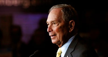 Democratic presidential candidate and former New York City Mayor Michael Bloomberg talks to supporters, in Detroit. Bloomberg won the votes of New Hampshire's Dixville Notch community, hanging onto its tradition of being among the first to cast ballots in