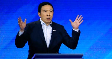 Democratic presidential candidate entrepreneur Andrew Yang speaks during a Democratic presidential primary debate at Saint Anselm College in Manchester, N.H.