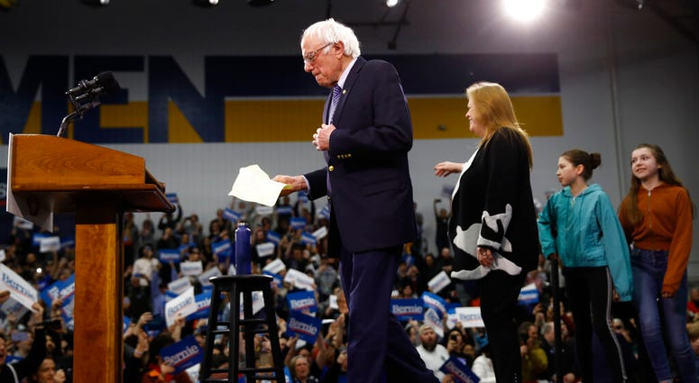 Democratic presidential candidate Sen. Bernie Sanders, I-Vt., arrives to speak to supporters at a primary night election rally in Manchester, N.H., Tuesday, Feb. 11, 2020.
