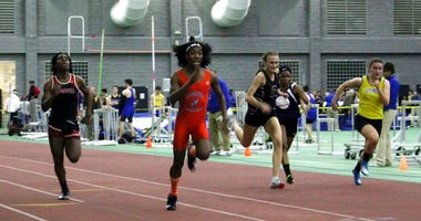 Bloomfield High School transgender athlete Terry Miller, second from left, wins the final of the 55-meter dash over transgender athlete Andraya Yearwood, far left